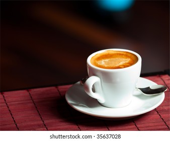 white Cup of coffee espresso on the table