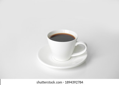 White cup of coffee on the white background.