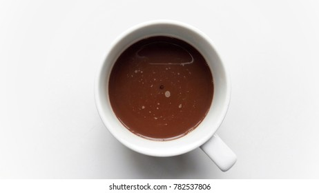 A white cup of coffee on the white background. Coffee is a beverage can help you to recharge the energy
