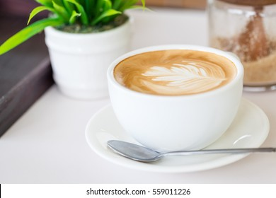 White cup of coffee on the table