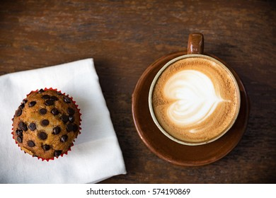 White cup of coffee on vintage wood. Top view , cup on wooden table. View from top , break or breakfast