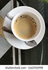 white cup of coffee with top view.coffee break.