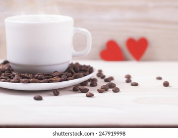 White cup of fresh coffee with red hearts.Card for text