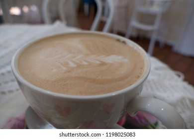 a white cup of fresh hot tasty capuccino