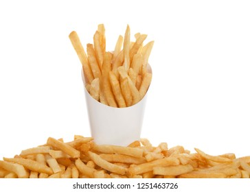 White cup full of french fries with french fries below on table isolated on white background. French fries have been popularized worldwide in large part by the large American fast food chains.