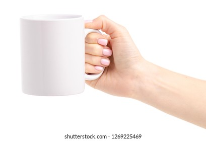 White cup mug in female hand on white background isolation