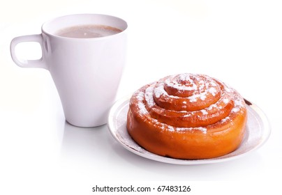 White cup office coffee with milk and a fresh sweet roll with cinnamon on a white saucer with a gold border isolated on a white background