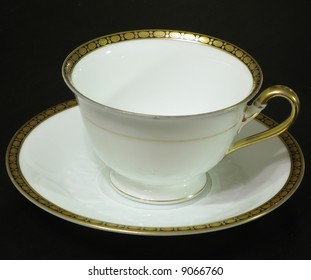 white cup on the black table