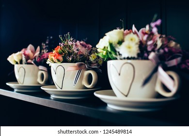 white cup with a picture of the heart. Flowers March 8th. Flowers for Valentine's Day. Mothers Day.