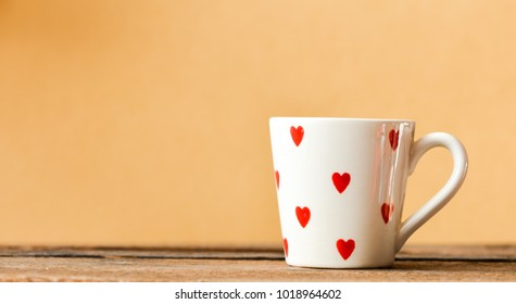 white cup with red heart pattern on beige background, Valentine day concept