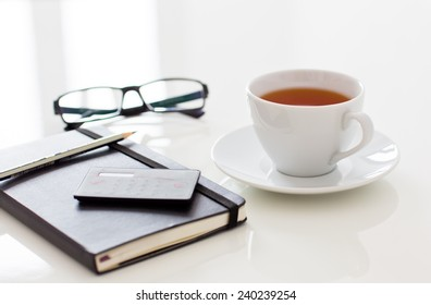 White cup of tea on table