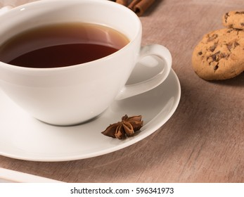 White cup of tea on a tray with cookie and chicory
