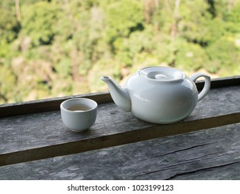 White Cup of tea and teakettle on wooden bar at Doi-Montngo , Chiang Mai, Thailand