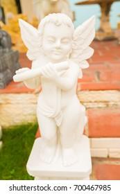 white Cupid child sculpture in Vietnam