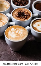 White cups of different stages of preparing cappuccino. Cofee lover concept still life