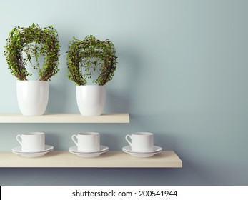 White cups and flowerpot on the shelf in front of gray wall.