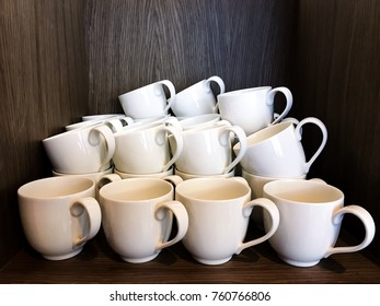 White cups on shelf, waiting for use in restaurant