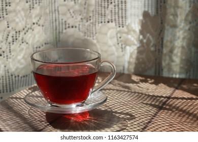white curtain and hibiscus tea