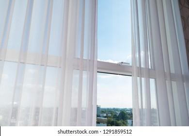 white curtain on glass window