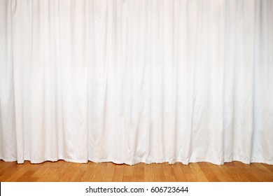 White curtain on windows and wooden floor in room at home