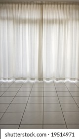 White curtains and white floor with tiles
