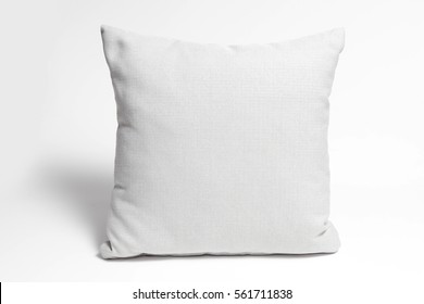white cushion on white background