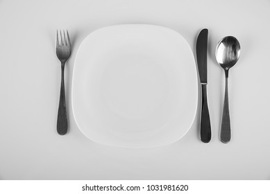 White cutlery on a white background