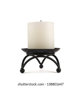 White cylindrical candle on the black forged metal stand, isolated over white background