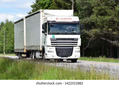 White DAF truck vehicle with Agrenta sign on the highway in sunny and summer season - Kongsvinger, Norway (6th june 2019)