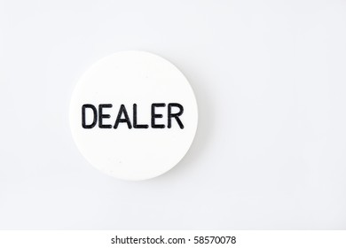 white dealer button of a poker game on white background