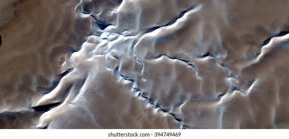 White death,abstract photography of the deserts of Africa from the air, bird's eye view, abstract expressionism, contemporary art, optical illusions,