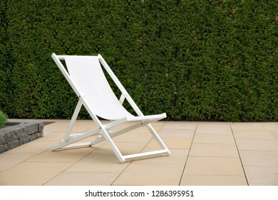 White deck chair on a stone terrace