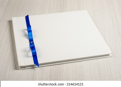 White decorated wedding guest book on the bright table