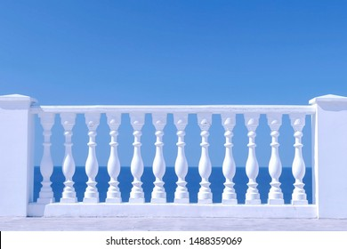 White decorative fence made of concrete with column on the sea waterfront, closeup view.