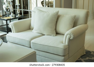 white decorative pillows on a casual sofa in the living room