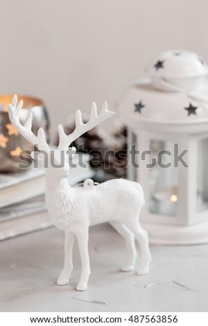 white deer christmas decoration on light background christmas card shallow focus