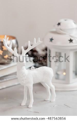 white deer christmas decoration on light background christmas card shallow focus - White Deer Christmas Decoration