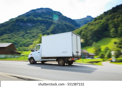 White Delivery Van With Alps In Background