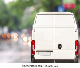 White delivery Van driving fast on city blurr bokeh street