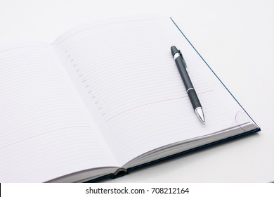 white desk, notebook with pen, background, space for records, copy space