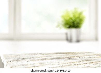 White desk space fo free place for your decoration and window with small green plant.