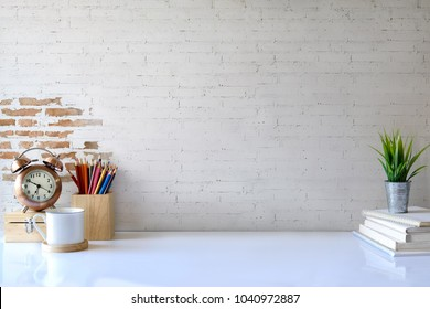 White desk table with copy space, supplies and coffee mug. Front view workspace and copy space