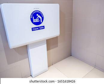 White diaper table changing station on the wall for baby changing diaper to facilitate to children parents in the airport.