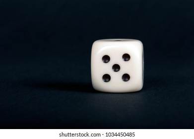 white dice against black background, close-up
