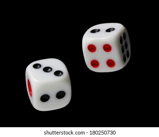 white dice falling on black background