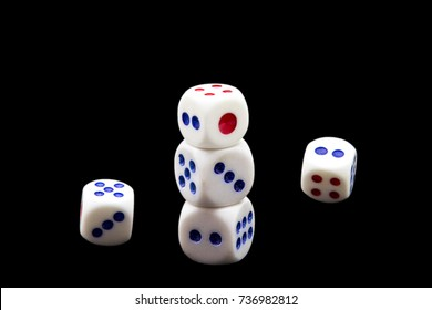 White dice on black background