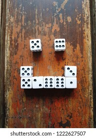White dice on an old vintage table.