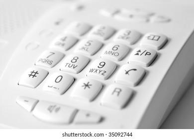 white digital phone keypad with center focus