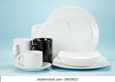 white dishware on the blue background