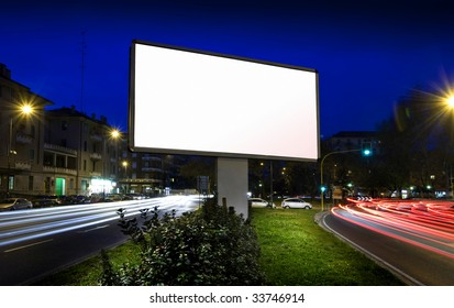 white display advertising with traffic at night